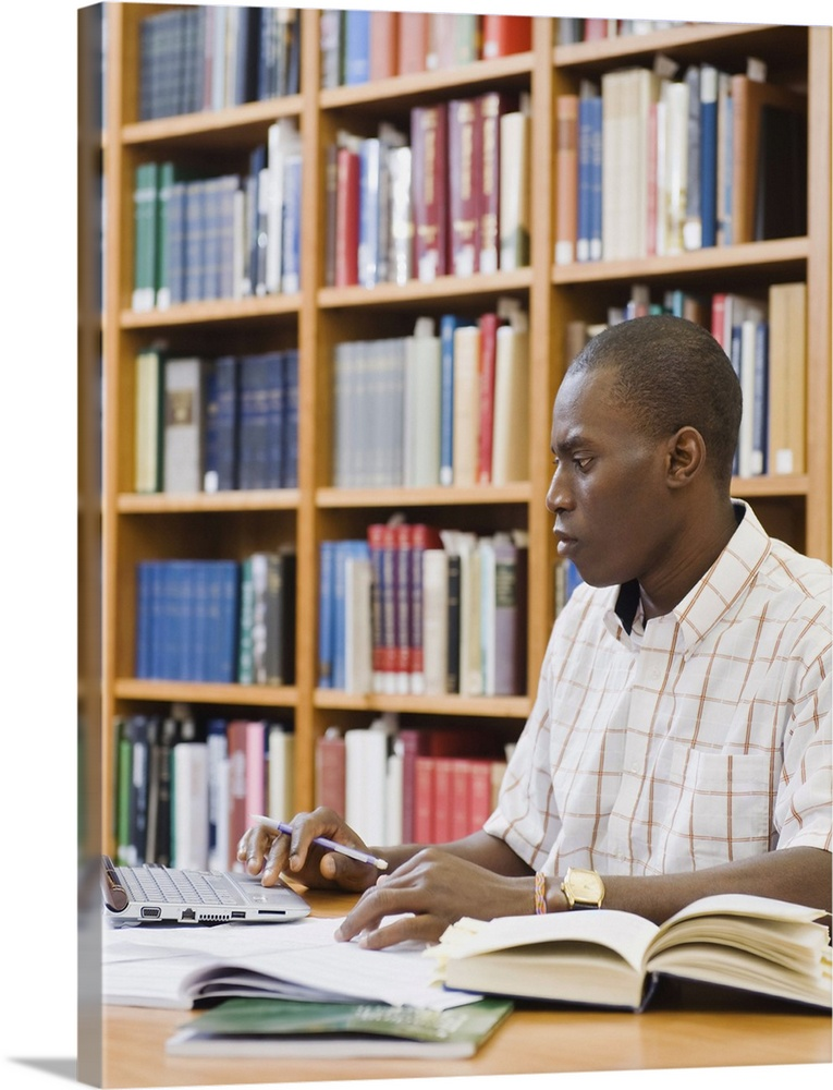 Solid-Faced Canvas Print Wall Art entitled College student working in library