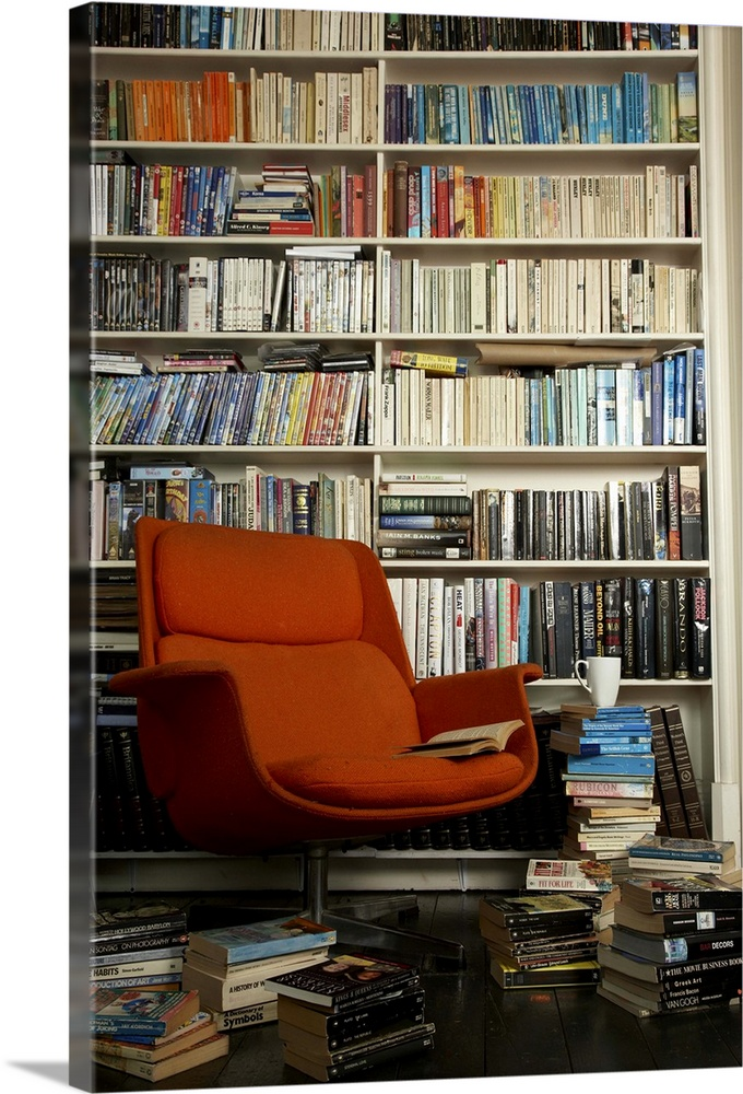 Large Solid-Faced Canvas Print Wall Art Print 20 x 30 entitled comfortable chair surrounded by books Solid-Faced Canvas Print entitled comfortable chair surrounded by books.  Multiple sizes available.  Primary colors within this image include Dark Red, Black, Silver, Dark Forest Green.  Made in the USA.  Satisfaction guaranteed.  Archival-quality UV-resistant inks.  Canvas depth is 1.25 and includes a finished backing with pre-installed hanging hardware.  Featuring a proprietary design, our canvases produce the tightest corners without any bubbles, ripples, or bumps and will not warp or sag over time.