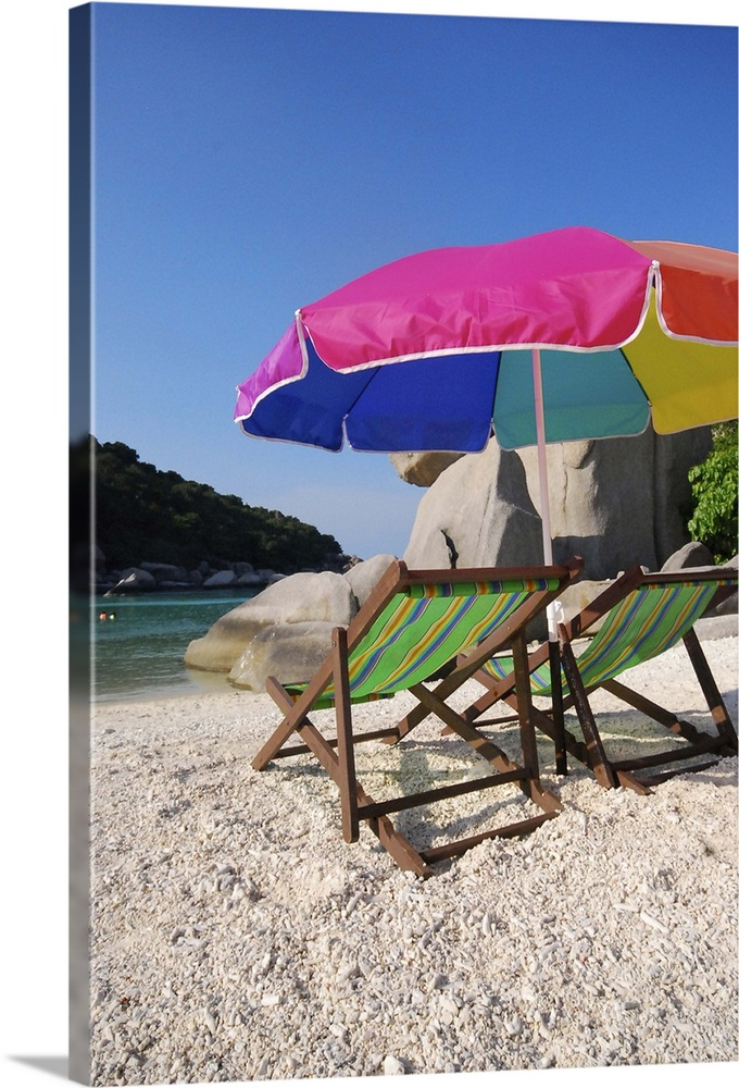 Large Solid-Faced Canvas Print Wall Art Print 20 x 30 entitled Deck chairs on a beach in Koh Nang Yuan, Thailand. Solid-Faced Canvas Print entitled Deck chairs on a beach in Koh Nang Yuan, Thailand..  Multiple sizes available.  Primary colors within this image include Fuschia, White, Dark Forest Green, Royal Blue.  Made in USA.  Satisfaction guaranteed.  Inks used are latex-based and designed to last.  Canvas depth is 1.25 and includes a finished backing with pre-installed hanging hardware.  Featuring a proprietary design, our canvases produce the tightest corners without any bubbles, ripples, or bumps and will not warp or sag over time.