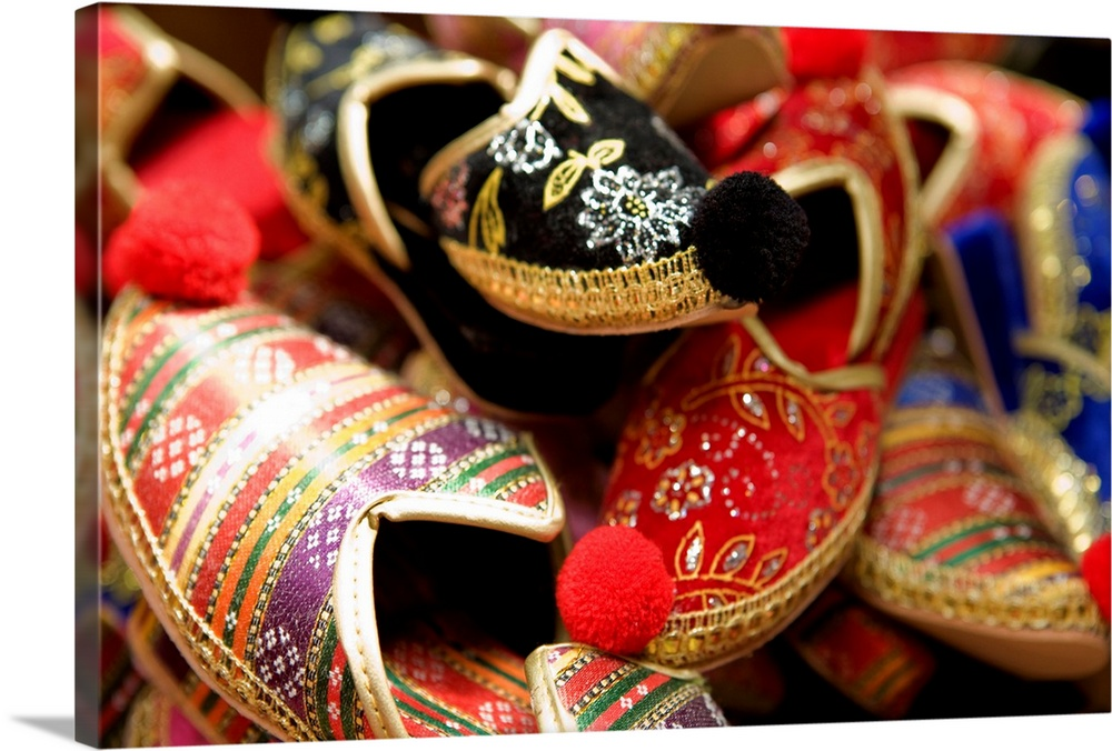 Large Solid-Faced Canvas Print Wall Art Print 30 x 20 entitled Display of traditional Turkish slippers Solid-Faced Canvas Print entitled Display of traditional Turkish slippers.  Colourful shoes for sale at the Grand Bazaar.  Multiple sizes available.  Primary colors within this image include Red, Dark Red, Pink, Dark Navy Blue.  Made in USA.  Satisfaction guaranteed.  Archival-quality UV-resistant inks.  Canvas is handcrafted and made-to-order in the United States using high quality artist-grade canvas.  Archival inks prevent fading and preserve as much fine detail as possible with no over-saturation or color shifting.