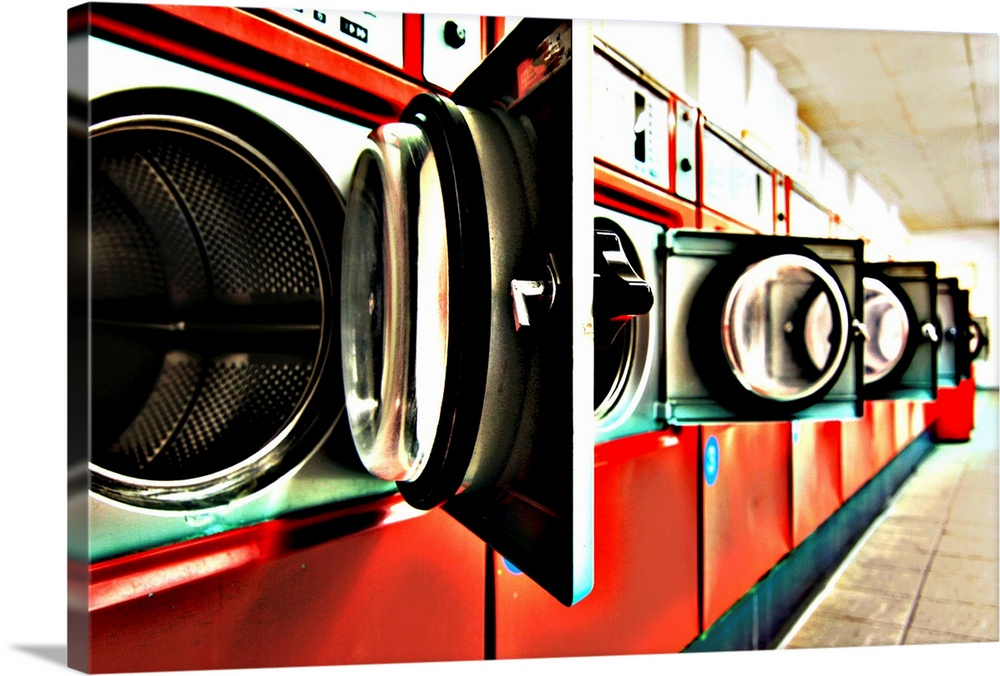Large Solid-Faced Canvas Print Wall Art Print 30 x 20 entitled Dryers in laundromat Solid-Faced Canvas Print entitled Dryers in laundromat.  open doors of washing machine at Launderette.  Multiple sizes available.  Primary colors within this image include Red, Dark Red, Black, White.  Made in USA.  Satisfaction guaranteed.  Inks used are latex-based and designed to last.  Archival inks prevent fading and preserve as much fine detail as possible with no over-saturation or color shifting.  Canvas depth is 1.25 and includes a finished backing with pre-installed hanging hardware.