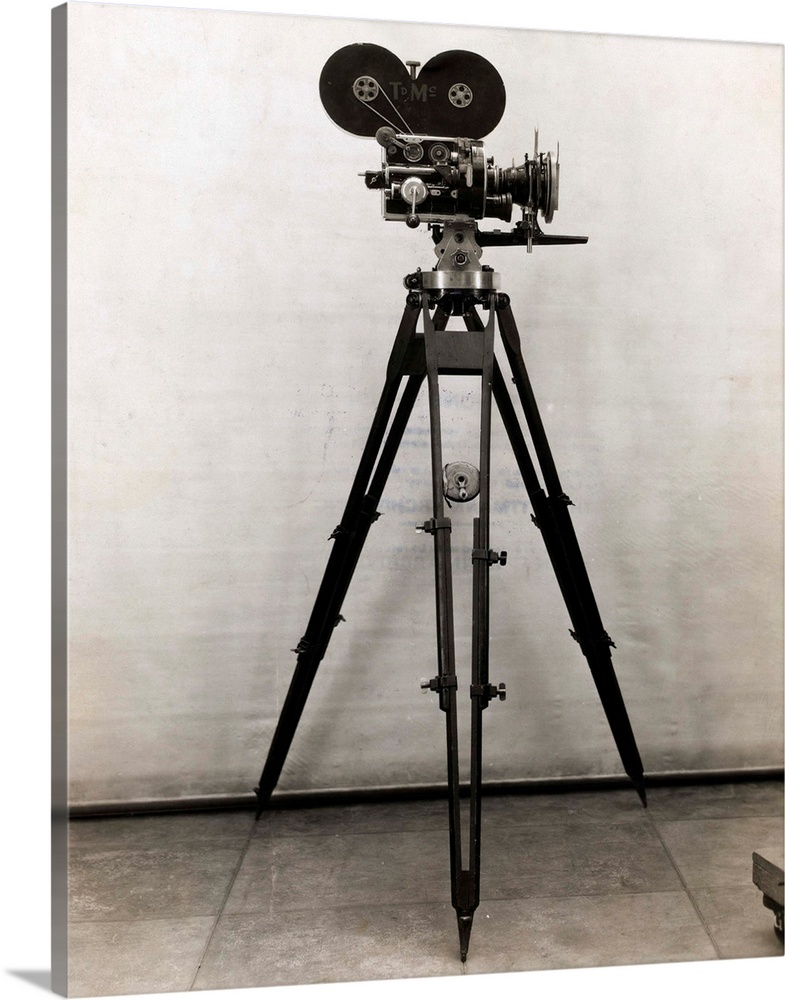 Large Solid-Faced Canvas Print Wall Art Print 24 x 30 entitled Early Movie Camera on Tripod Solid-Faced Canvas Print entitled Early Movie Camera on Tripod.  Movie camera on tripod. Undated photograph. BPA2.  Multiple sizes available.  Primary colors within this image include Black, Gray, White.  Made in USA.  All products come with a 365 day workmanship guarantee.  Inks used are latex-based and designed to last.  Canvas depth is 1.25 and includes a finished backing with pre-installed hanging hardware.  Archival inks prevent fading and preserve as much fine detail as possible with no over-saturation or color shifting.