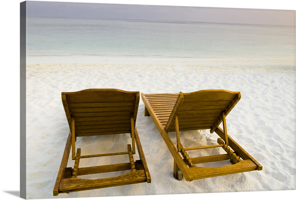Large Solid-Faced Canvas Print Wall Art Print 30 x 20 entitled Empty beach chairs, Maldives. Solid-Faced Canvas Print entitled Empty beach chairs, Maldives..  Multiple sizes available.  Primary colors within this image include Brown, Black, White.  Made in the USA.  All products come with a 365 day workmanship guarantee.  Archival-quality UV-resistant inks.  Canvas is handcrafted and made-to-order in the United States using high quality artist-grade canvas.  Archival inks prevent fading and preserve as much fine detail as possible with no over-saturation or color shifting.