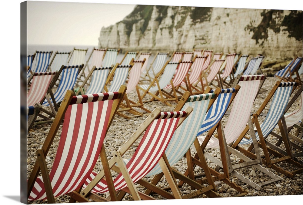 Large Solid-Faced Canvas Print Wall Art Print 30 x 20 entitled Empty deck chairs on beach at Beer, Devon, with cliffs and ... Solid-Faced Canvas Print entitled Empty deck chairs on beach at Beer, Devon, with cliffs and sea in background..  Eempty deck chairs on beach at Beer, Devon out of season, with cliffs and sea in background.  Multiple sizes available.  Primary colors within this image include Brown, Black, Silver, Muted Blue.  Made in USA.  All products come with a 365 day workmanship guarantee.  Inks used are latex-based and designed to last.  Canvas depth is 1.25 and includes a finished backing with pre-installed hanging hardware.  Canvas is handcrafted and made-to-order in the United States using high quality artist-grade canvas.
