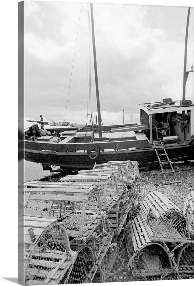 Large Solid-Faced Canvas Print Wall Art Print 20 x 30 entitled Fishing time Solid-Faced Canvas Print entitled Fishing time.  black and white image of fishing vessel and lobster traps.  Multiple sizes available.  Primary colors within this image include Black, Gray, Silver.  Made in USA.  All products come with a 365 day workmanship guarantee.  Archival-quality UV-resistant inks.  Archival inks prevent fading and preserve as much fine detail as possible with no over-saturation or color shifting.  Canvas is handcrafted and made-to-order in the United States using high quality artist-grade canvas.