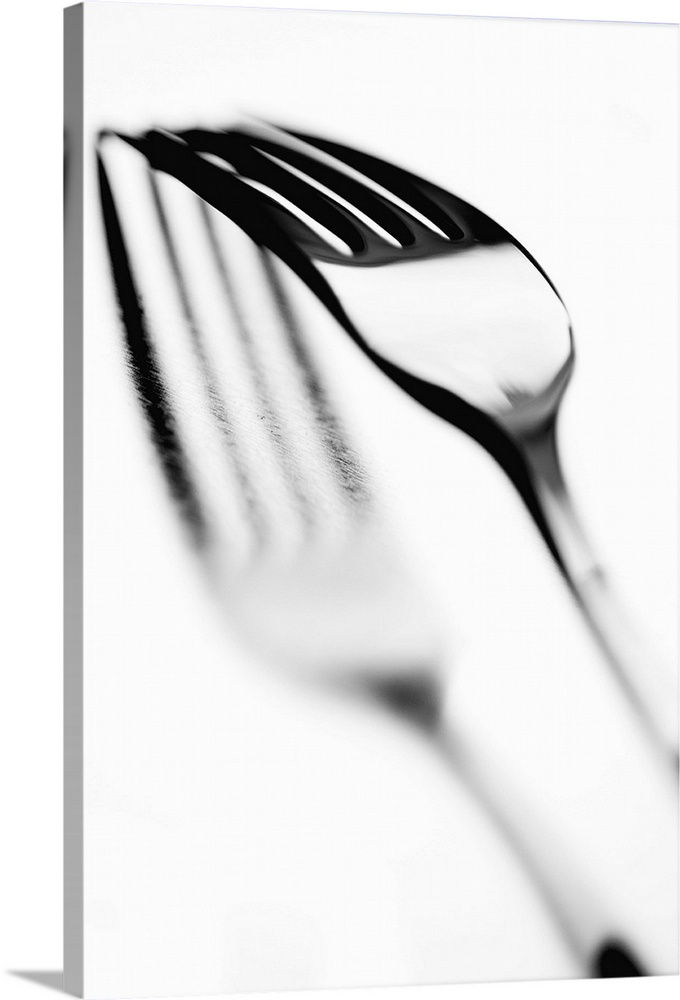 Large Solid-Faced Canvas Print Wall Art Print 20 x 30 entitled Fork with shadow, close-up Solid-Faced Canvas Print entitled Fork with shadow, close-up.  Multiple sizes available.  Primary colors within this image include Black, Gray, White.  Made in the USA.  Satisfaction guaranteed.  Inks used are latex-based and designed to last.  Canvas depth is 1.25 and includes a finished backing with pre-installed hanging hardware.  Archival inks prevent fading and preserve as much fine detail as possible with no over-saturation or color shifting.