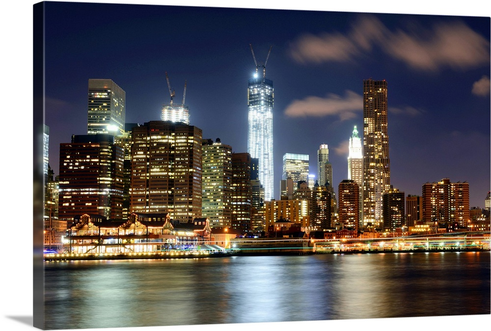 Large Solid-Faced Canvas Print Wall Art Print 36 x 24 entitled Freedom tower, NYC Solid-Faced Canvas Print entitled Freedom tower, NYC.  Freedom Tower, One World Trade Center, night, East River, Downtown Manhattan, Manhattan, New York City, skyline, cityscape, construction.  Multiple sizes available.  Primary colors within this image include Brown, Light Yellow, White, Dark Navy Blue.  Made in USA.  All products come with a 365 day workmanship guarantee.  Inks used are latex-based and designed to last.  Canvas is handcrafted and made-to-order in the United States using high quality artist-grade canvas.  Archival inks prevent fading and preserve as much fine detail as possible with no over-saturation or color shifting.
