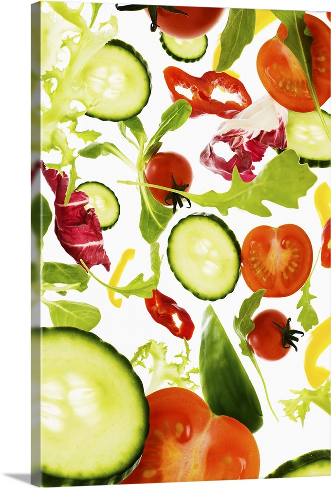 Large Gallery-Wrapped Canvas Wall Art Print 16 x 24 entitled Fresh mixed salad vegetables falling to camera Gallery-Wrapped Canvas entitled Fresh mixed salad vegetables falling to camera.  Multiple sizes available.  Primary colors within this image include Orange Brown White Lime Green.  Made in the USA.  All products come with a 365 day workmanship guarantee.  Archival-quality UV-resistant inks.  Canvases are stretched across a 1.5 inch thick wooden frame with easy-to-mount hanging hardware.  Canvas is a 65 polyester 35 cotton base with two acrylic latex primer basecoats and a semi-gloss inkjet receptive topcoat.