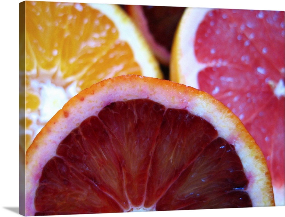 Large Solid-Faced Canvas Print Wall Art Print 40 x 30 entitled Fruity love Solid-Faced Canvas Print entitled Fruity love.  Many types of citrus blood orange, orange and grapefruit in loving harmony.  Multiple sizes available.  Primary colors within this image include Dark Red, Dark Yellow, Pink, Pale Blue.  Made in USA.  Satisfaction guaranteed.  Inks used are latex-based and designed to last.  Featuring a proprietary design, our canvases produce the tightest corners without any bubbles, ripples, or bumps and will not warp or sag over time.  Archival inks prevent fading and preserve as much fine detail as possible with no over-saturation or color shifting.