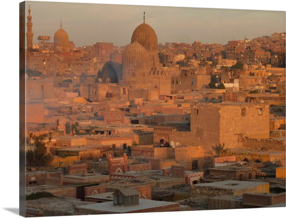 Large Solid-Faced Canvas Print Wall Art Print 40 x 30 entitled Glorious time to capture this side of Islamic Cairo bathed ... Solid-Faced Canvas Print entitled Glorious time to capture this side of Islamic Cairo bathed in soft glow of sunset amber..  Multiple sizes available.  Primary colors within this image include Brown, Dark Gray, Light Gray.  Made in USA.  Satisfaction guaranteed.  Inks used are latex-based and designed to last.  Canvas is handcrafted and made-to-order in the United States using high quality artist-grade canvas.  Archival inks prevent fading and preserve as much fine detail as possible with no over-saturation or color shifting.