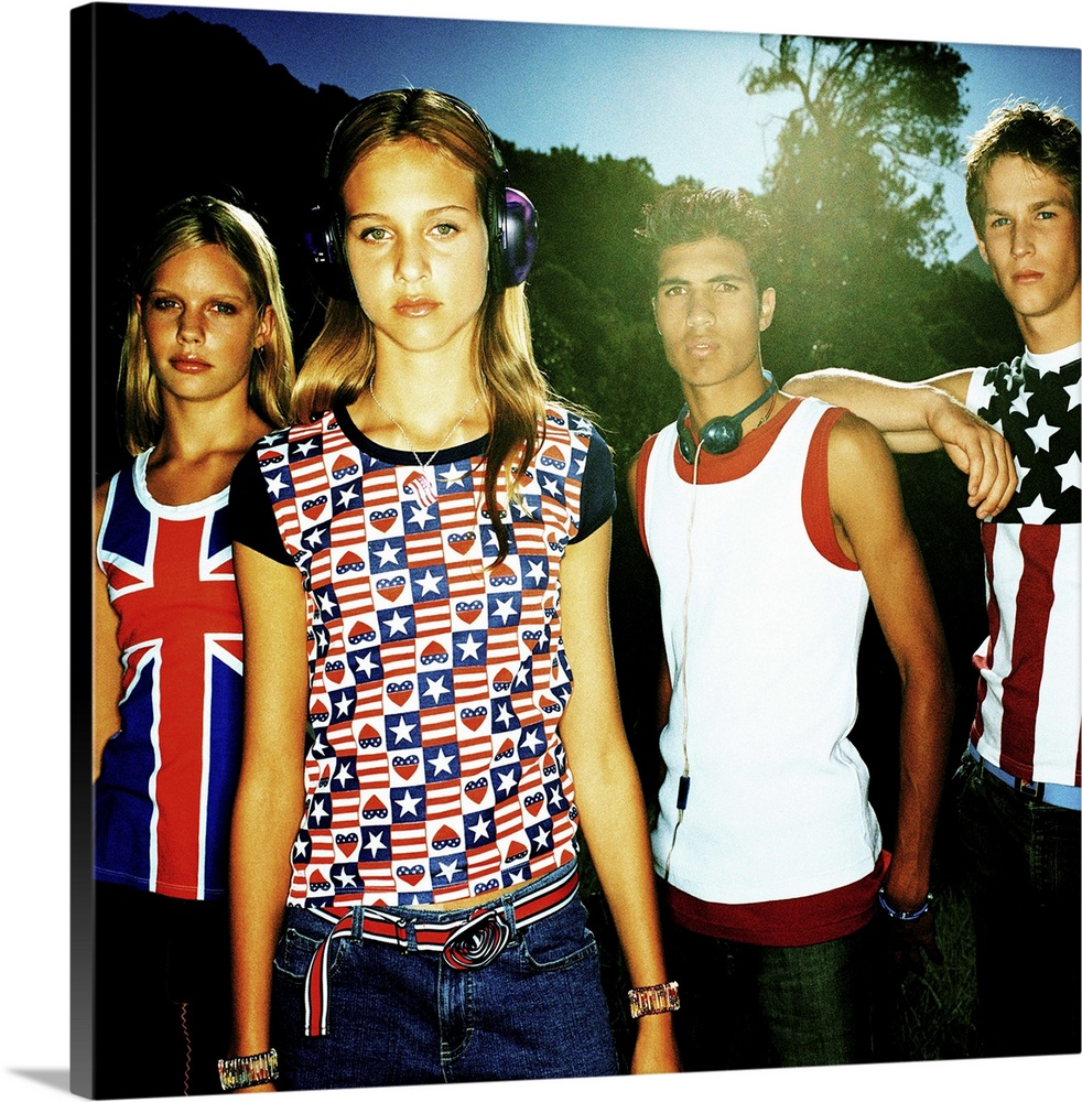 Large Gallery-Wrapped Canvas Wall Art Print 16 x 16 entitled Group of teenagers (14-16) standing and looking at camera Gallery-Wrapped Canvas entitled Group of teenagers 14-16 standing and looking at camera.  Multiple sizes available.  Primary colors within this image include Red Dark Blue Black White.  Made in USA.  Satisfaction guaranteed.  Inks used are latex-based and designed to last.  Museum-quality artist-grade canvas mounted on sturdy wooden stretcher bars 1.5 thick.  Comes ready to hang.  Canvas frames are built with farmed or reclaimed domestic pine or poplar wood.