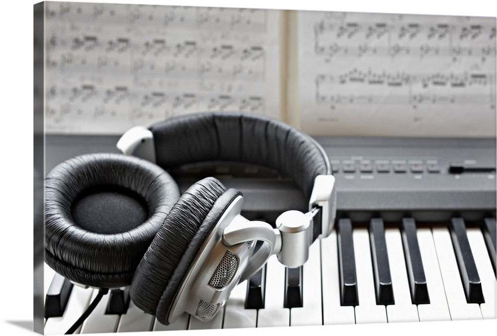 Large Solid-Faced Canvas Print Wall Art Print 30 x 20 entitled Headphones on electronic piano keyboard Solid-Faced Canvas Print entitled Headphones on electronic piano keyboard.  Multiple sizes available.  Primary colors within this image include Black, Light Gray, White.  Made in the USA.  Satisfaction guaranteed.  Archival-quality UV-resistant inks.  Canvas is handcrafted and made-to-order in the United States using high quality artist-grade canvas.  Archival inks prevent fading and preserve as much fine detail as possible with no over-saturation or color shifting.