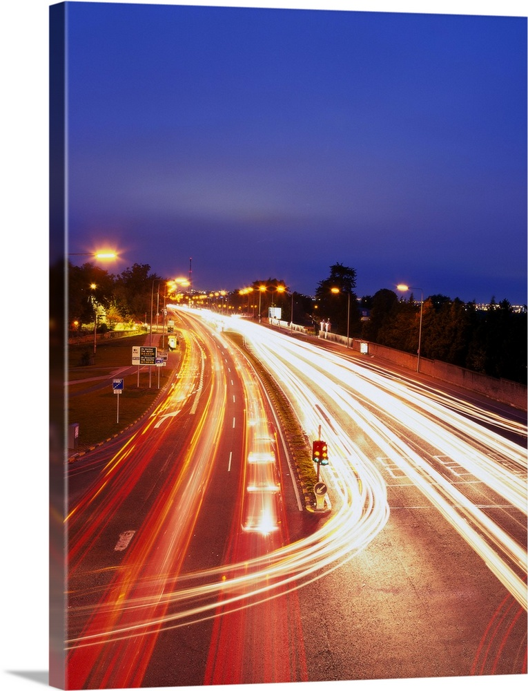 Large Solid-Faced Canvas Print Wall Art Print 30 x 40 entitled high angle time lapse view of traffic movement on a highway Solid-Faced Canvas Print entitled high angle time lapse view of traffic movement on a highway.  Multiple sizes available.  Primary colors within this image include Brown, Dark Blue, Peach, Black.  Made in the USA.  Satisfaction guaranteed.  Inks used are latex-based and designed to last.  Featuring a proprietary design, our canvases produce the tightest corners without any bubbles, ripples, or bumps and will not warp or sag over time.  Canvas depth is 1.25 and includes a finished backing with pre-installed hanging hardware.