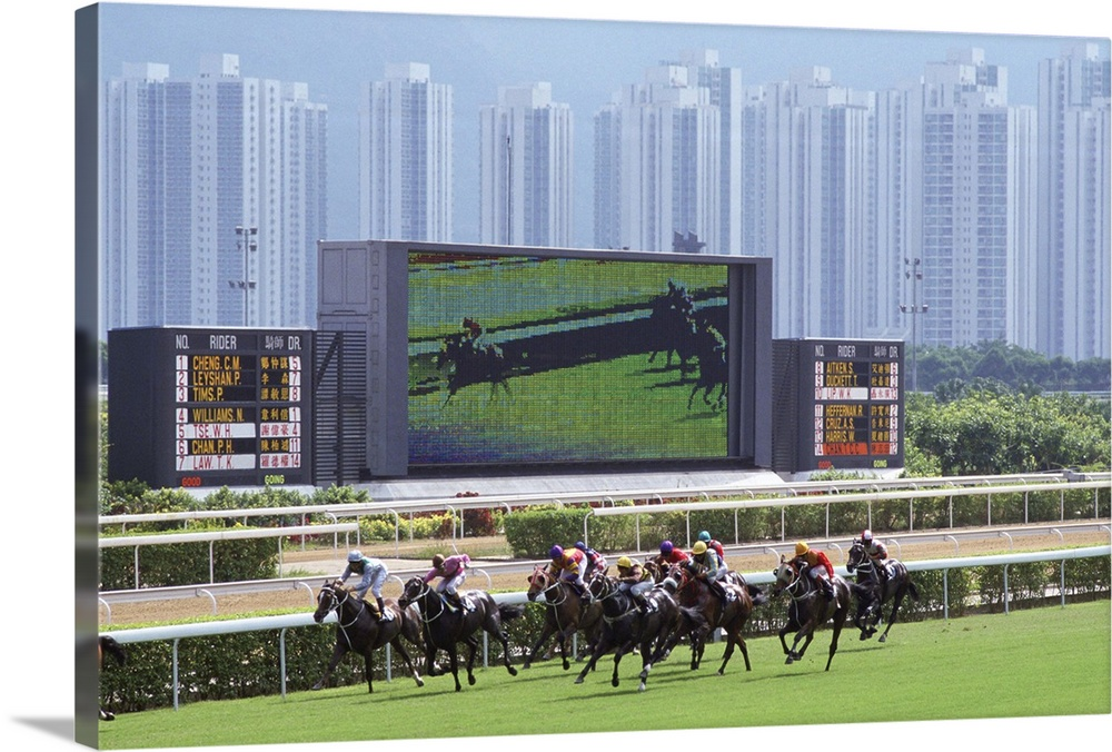 Large Gallery-Wrapped Canvas Wall Art Print 24 x 16 entitled Horse Race, Sha Tin, Hong Kong Gallery-Wrapped Canvas entitled Horse Race, Sha Tin, Hong Kong.  SHA TIN, HONG KONG - JANUARY 01  Sha Tin Races, Hong Kong. A giant television screen is behind the race track. .  Multiple sizes available.  Primary colors within this image include Forest Green, Black, Gray, Light Gray Blue.  Made in USA.  Satisfaction guaranteed.  Inks used are latex-based and designed to last.  Canvas is a 65 polyester, 35 cotton base, with two acrylic latex primer basecoats and a semi-gloss inkjet receptive topcoat.  Canvas is designed to prevent fading.