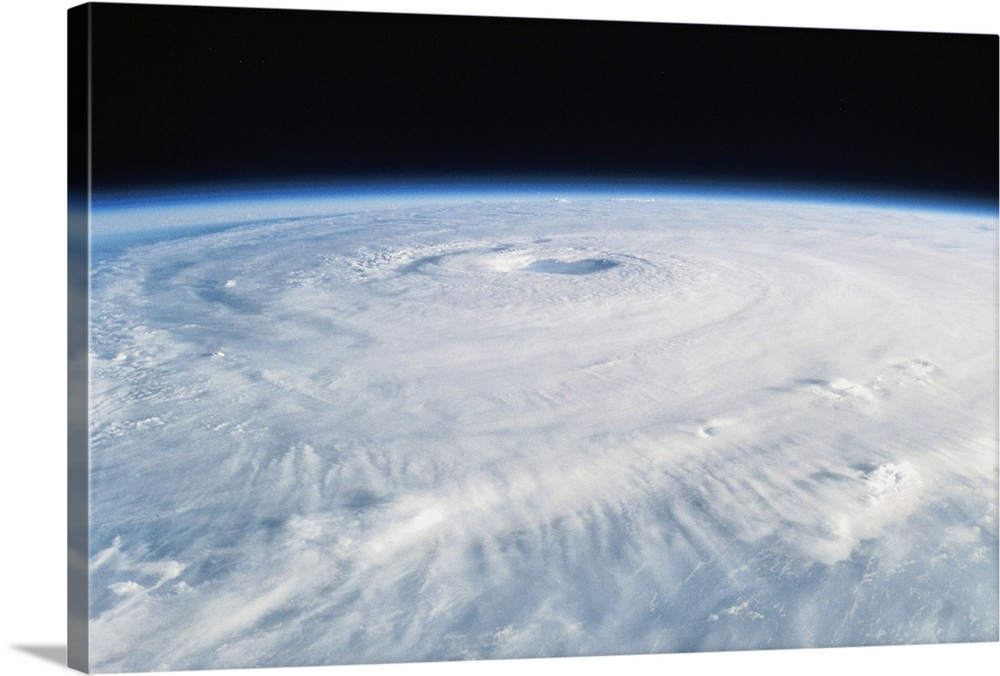 Large Solid-Faced Canvas Print Wall Art Print 30 x 20 entitled Hurricane Isabel, a Category 5 hurricane, from space Solid-Faced Canvas Print entitled Hurricane Isabel, a Category 5 hurricane, from space.  Hurricane Isabel happened in Sep 2003 and eventually reached Category 5 status, hitting North Carolina and Virginia.  Multiple sizes available.  Primary colors within this image include Black, Silver, Royal Blue.  Made in the USA.  All products come with a 365 day workmanship guarantee.  Inks used are latex-based and designed to last.  Canvas is handcrafted and made-to-order in the United States using high quality artist-grade canvas.  Featuring a proprietary design, our canvases produce the tightest corners without any bubbles, ripples, or bumps and will not warp or sag over time.