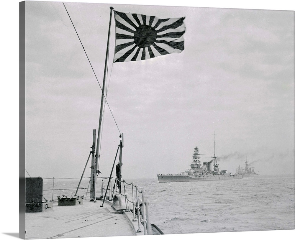 Large Solid-Faced Canvas Print Wall Art Print 30 x 24 entitled Japanese Warships Entering St. Jaques Solid-Faced Canvas Print entitled Japanese Warships Entering St. Jaques.  Japanese warships were today reported off Cap St. Jaques and Camranh Bay, French, Indo-China as France reportedly bowed to Japanese demand for bases in Southern Indo-China. Above a line of Japanese battleships with the Mitsu nearest camera. Granting of the Indo-China cases to Japans observers believe, marks beginning of long-threatened Japanese expansion to the South, with attacks on Singapore and Dutch East Indies only a matter of time.  Multiple sizes available.  Primary colors within this image include Dark Gray, Silver.  Made in USA.  All products come with a 365 day workmanship guarantee.  Inks used are latex-based and designed to last.  Featuring a proprietary design, our canvases produce the tightest corners without any bubbles, ripples, or bumps and will not warp or sag over time.  Canvas depth is 1.25 and includes a finished backing with pre-installed hanging hardware.