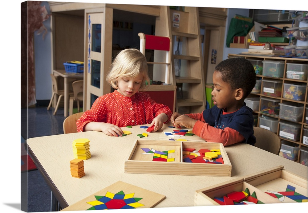 Large Solid-Faced Canvas Print Wall Art Print 30 x 20 entitled Kids matching wooden toys to patterns at school Solid-Faced Canvas Print entitled Kids matching wooden toys to patterns at school.  Multiple sizes available.  Primary colors within this image include Dark Red, Pink, Light Yellow, White.  Made in USA.  All products come with a 365 day workmanship guarantee.  Inks used are latex-based and designed to last.  Featuring a proprietary design, our canvases produce the tightest corners without any bubbles, ripples, or bumps and will not warp or sag over time.  Canvas is handcrafted and made-to-order in the United States using high quality artist-grade canvas.