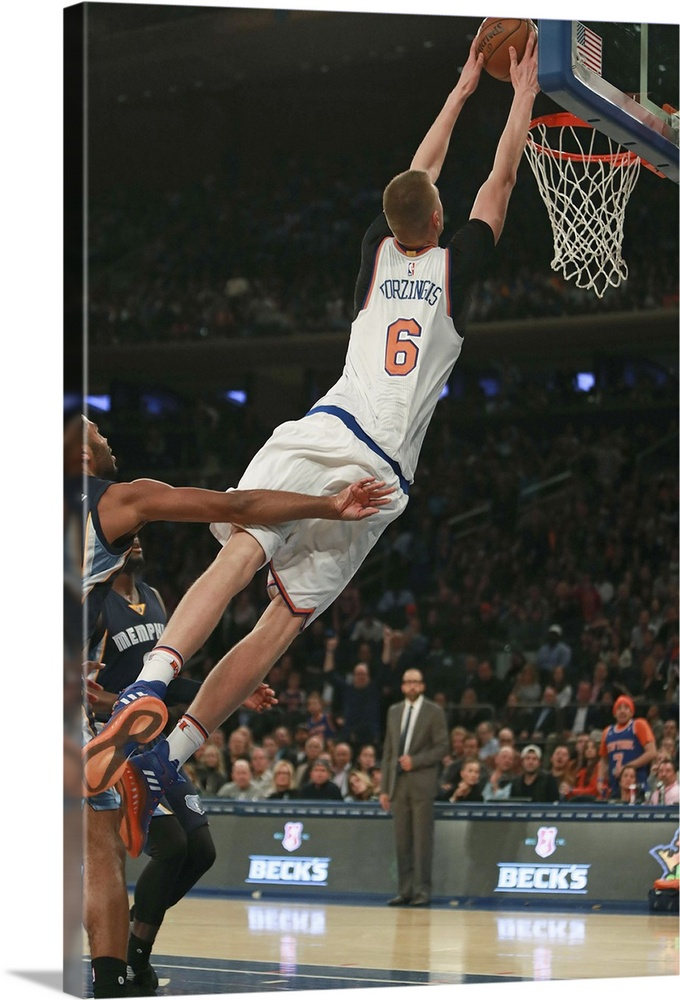 Large Gallery-Wrapped Canvas Wall Art Print 16 x 24 entitled Kristaps Porzingis 6 of the New York Knicks slams home a dunk Gallery-Wrapped Canvas entitled Kristaps Porzingis 6 of the New York Knicks slams home a dunk.  Kristaps Porzingis no.6 of the New York Knicks slams home a dunk against the Memphis Grizzlies during the second half at Madison Square Garden on October 29 2016 in New York City.  Multiple sizes available.  Primary colors within this image include Sky Blue Black Gray Silver.  Made in USA.  Satisfaction guaranteed.  Inks used are latex-based and designed to last.  Canvas is acid-free and 20 millimeters thick.  Canvas is designed to prevent fading.