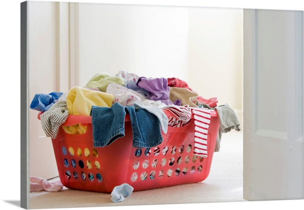 Large Gallery-Wrapped Canvas Wall Art Print 24 x 16 entitled Laundry basket with clothes Gallery-Wrapped Canvas entitled Laundry basket with clothes.  Multiple sizes available.  Primary colors within this image include Brown, Peach, Dark Gray, White.  Made in USA.  Satisfaction guaranteed.  Inks used are latex-based and designed to last.  Canvas is designed to prevent fading.  Canvas is a 65 polyester, 35 cotton base, with two acrylic latex primer basecoats and a semi-gloss inkjet receptive topcoat.