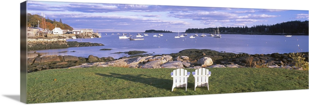 Large Solid-Faced Canvas Print Wall Art Print 48 x 16 entitled Lawn chairs at Lobster Village, Tenants Harbor, Maine Solid-Faced Canvas Print entitled Lawn chairs at Lobster Village, Tenants Harbor, Maine.  Lawn chairs at Lobster Village, Tenants Harbor, Maine.  Multiple sizes available.  Primary colors within this image include Light Gray, Dark Forest Green, Pale Blue.  Made in the USA.  Satisfaction guaranteed.  Archival-quality UV-resistant inks.  Archival inks prevent fading and preserve as much fine detail as possible with no over-saturation or color shifting.  Canvas depth is 1.25 and includes a finished backing with pre-installed hanging hardware.