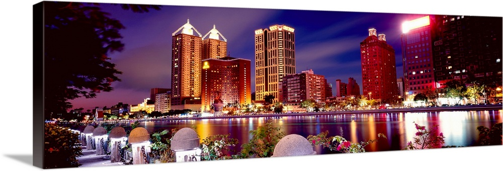 Large Solid-Faced Canvas Print Wall Art Print 48 x 16 entitled Love River in Kaohsiung, Taiwan Solid-Faced Canvas Print entitled Love River in Kaohsiung, Taiwan.  Multiple sizes available.  Primary colors within this image include Dark Red, Dark Blue, Black, White.  Made in USA.  Satisfaction guaranteed.  Inks used are latex-based and designed to last.  Featuring a proprietary design, our canvases produce the tightest corners without any bubbles, ripples, or bumps and will not warp or sag over time.  Canvas is handcrafted and made-to-order in the United States using high quality artist-grade canvas.