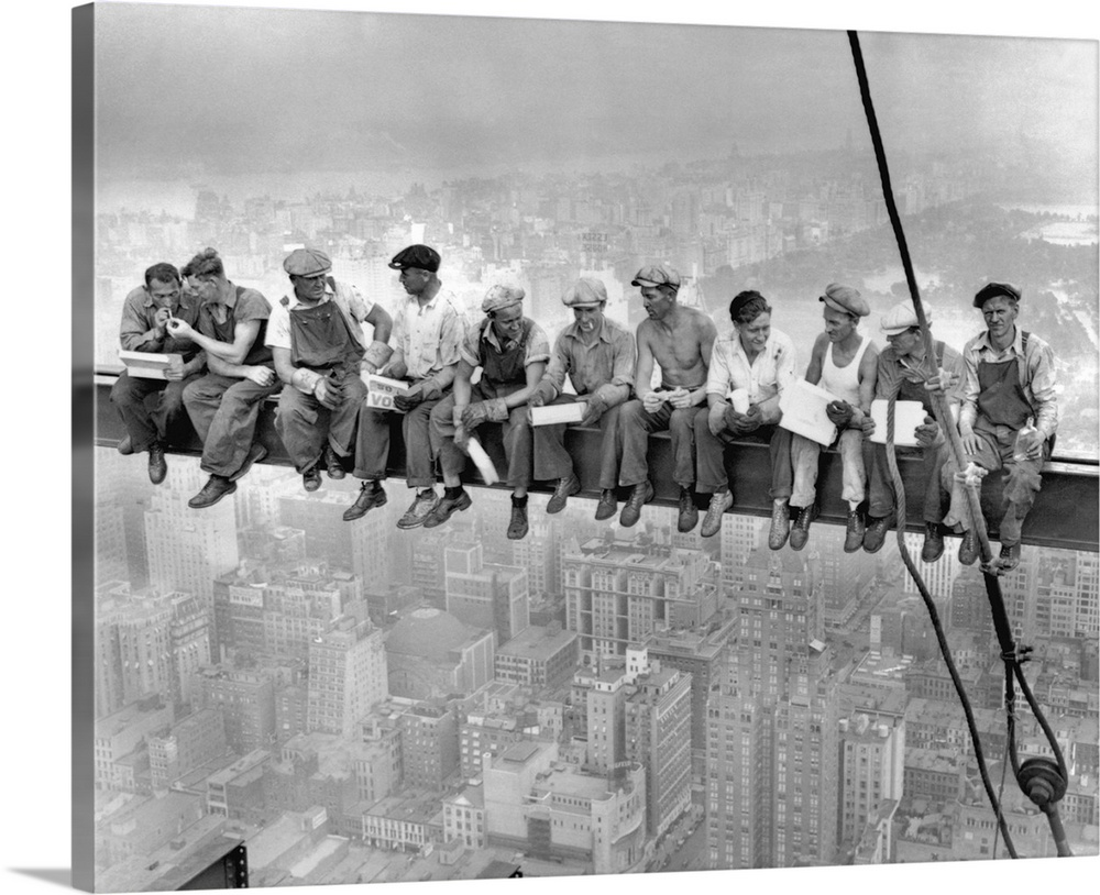 Large Solid-Faced Canvas Print Wall Art Print 45 x 36 entitled Lunch atop a skyscraper Solid-Faced Canvas Print entitled Lunch atop a skyscraper.  While New Yorks thousands rush to crowded restaurants and congested lunch counters for their noon day lunch, these intrepid steel workers atop the 70 story RCA building in Rockefeller Center get all the air and freedom they want by lunching on a steel beam with a sheer drop of over 800 feet to the street level. The RCA building is the largest office building in terms of office space in the world. original caption. Image taken 92032 filed 92932.  Multiple sizes available.  Primary colors within this image include Dark Gray, Silver.  Made in USA.  Satisfaction guaranteed.  Archival-quality UV-resistant inks.  Featuring a proprietary design, our canvases produce the tightest corners without any bubbles, ripples, or bumps and will not warp or sag over time.  Canvas depth is 1.25 and includes a finished backing with pre-installed hanging hardware.