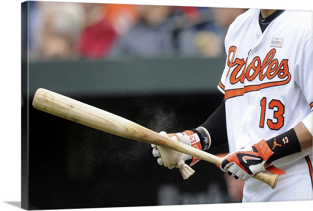 Large Solid-Faced Canvas Print Wall Art Print 30 x 20 entitled Manny Machado of the Baltimore Orioles wears Nike batting g... Solid-Faced Canvas Print entitled Manny Machado of the Baltimore Orioles wears Nike batting gloves.  Manny Machado no.13 of the Baltimore Orioles wears Nike batting gloves during the game against the Detroit Tigers at Oriole Park at Camden Yards on May 15, 2016 in Baltimore, Maryland.  Multiple sizes available.  Primary colors within this image include Dark Red, Pink, Black, White.  Made in the USA.  Satisfaction guaranteed.  Inks used are latex-based and designed to last.  Archival inks prevent fading and preserve as much fine detail as possible with no over-saturation or color shifting.  Canvas depth is 1.25 and includes a finished backing with pre-installed hanging hardware.