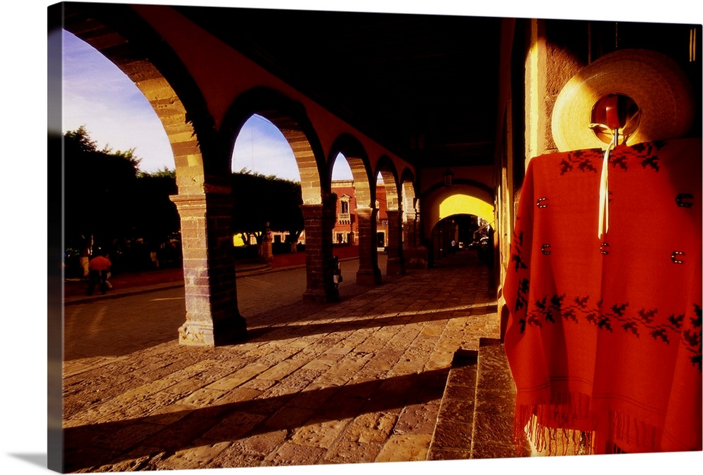 Large Solid-Faced Canvas Print Wall Art Print 30 x 20 entitled Mexican Clothing Near Jardin Square Solid-Faced Canvas Print entitled Mexican Clothing Near Jardin Square.  Multiple sizes available.  Primary colors within this image include Dark Red, Brown, Light Yellow, Black.  Made in the USA.  Satisfaction guaranteed.  Archival-quality UV-resistant inks.  Archival inks prevent fading and preserve as much fine detail as possible with no over-saturation or color shifting.  Canvas is handcrafted and made-to-order in the United States using high quality artist-grade canvas.