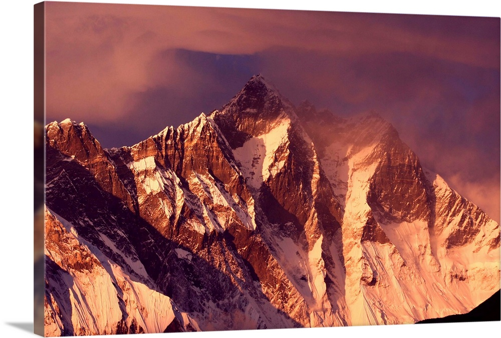 Large Solid-Faced Canvas Print Wall Art Print 30 x 20 entitled Mt. Lhotse in the Nepal Himalayas at sunset time, Everest R... Solid-Faced Canvas Print entitled Mt. Lhotse in the Nepal Himalayas at sunset time, Everest Region.  Multiple sizes available.  Primary colors within this image include Dark Red, Peach, Black, Gray.  Made in the USA.  All products come with a 365 day workmanship guarantee.  Archival-quality UV-resistant inks.  Canvas depth is 1.25 and includes a finished backing with pre-installed hanging hardware.  Featuring a proprietary design, our canvases produce the tightest corners without any bubbles, ripples, or bumps and will not warp or sag over time.