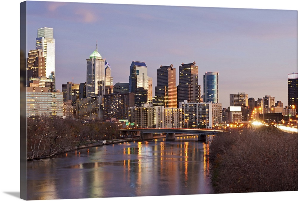 Large Solid-Faced Canvas Print Wall Art Print 30 x 20 entitled Night time panoramic view at Philadelphia downtown Solid-Faced Canvas Print entitled Night time panoramic view at Philadelphia downtown.  Night time panoramic view at Philadelphia downtown landmark skyscrapers with reflections in Schuylkill River.  Multiple sizes available.  Primary colors within this image include Light Yellow, Black, Gray, Light Gray Blue.  Made in USA.  Satisfaction guaranteed.  Archival-quality UV-resistant inks.  Canvas is handcrafted and made-to-order in the United States using high quality artist-grade canvas.  Canvas depth is 1.25 and includes a finished backing with pre-installed hanging hardware.
