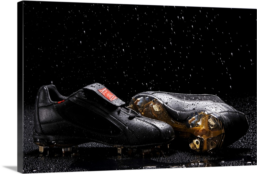 Large Solid-Faced Canvas Print Wall Art Print 30 x 20 entitled Pair of soccer shoes Solid-Faced Canvas Print entitled Pair of soccer shoes.  Multiple sizes available.  Primary colors within this image include Brown, Black, Gray, White.  Made in the USA.  All products come with a 365 day workmanship guarantee.  Inks used are latex-based and designed to last.  Canvas is handcrafted and made-to-order in the United States using high quality artist-grade canvas.  Canvas depth is 1.25 and includes a finished backing with pre-installed hanging hardware.