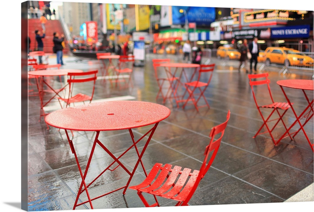 Large Solid-Faced Canvas Print Wall Art Print 30 x 20 entitled Red Chairs in Times Square, New York City Solid-Faced Canvas Print entitled Red Chairs in Times Square, New York City.  Multiple sizes available.  Primary colors within this image include Orange, Dark Red, Dark Blue, Pink.  Made in USA.  All products come with a 365 day workmanship guarantee.  Archival-quality UV-resistant inks.  Featuring a proprietary design, our canvases produce the tightest corners without any bubbles, ripples, or bumps and will not warp or sag over time.  Canvas depth is 1.25 and includes a finished backing with pre-installed hanging hardware.