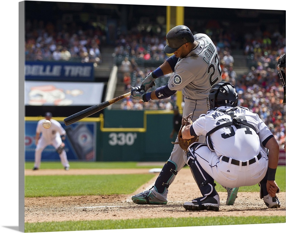 Large Solid-Faced Canvas Print Wall Art Print 30 x 24 entitled Robinson Cano of the Seattle Mariners swings and makes contact Solid-Faced Canvas Print entitled Robinson Cano of the Seattle Mariners swings and makes contact.  Robinson Cano no.22 of the Seattle Mariners swings and makes contact against the Detroit Tigers at Comerica Park on July 23, 2015 in Detroit, Michigan. The Mariners defeated the Tigers 3-2 in extra innings.  Multiple sizes available.  Primary colors within this image include Brown, Dark Yellow, Black, White.  Made in the USA.  All products come with a 365 day workmanship guarantee.  Archival-quality UV-resistant inks.  Canvas is handcrafted and made-to-order in the United States using high quality artist-grade canvas.  Archival inks prevent fading and preserve as much fine detail as possible with no over-saturation or color shifting.