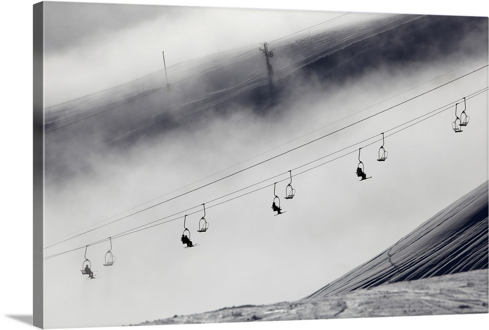 Large Solid-Faced Canvas Print Wall Art Print 30 x 20 entitled Skiers on a chair lift Solid-Faced Canvas Print entitled Skiers on a chair lift.  Multiple sizes available.  Primary colors within this image include Black, Gray, Silver.  Made in USA.  All products come with a 365 day workmanship guarantee.  Inks used are latex-based and designed to last.  Canvas is handcrafted and made-to-order in the United States using high quality artist-grade canvas.  Archival inks prevent fading and preserve as much fine detail as possible with no over-saturation or color shifting.
