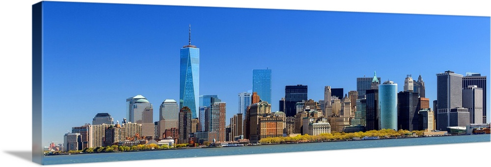 Large Solid-Faced Canvas Print Wall Art Print 60 x 20 entitled Skyline of New York with one World Trade Center Solid-Faced Canvas Print entitled Skyline of New York with one World Trade Center.  New-York with the Freedom Tower, One World Trade Center.  Multiple sizes available.  Primary colors within this image include Brown, Dark Yellow, Black, Royal Blue.  Made in the USA.  All products come with a 365 day workmanship guarantee.  Inks used are latex-based and designed to last.  Archival inks prevent fading and preserve as much fine detail as possible with no over-saturation or color shifting.  Canvas is handcrafted and made-to-order in the United States using high quality artist-grade canvas.