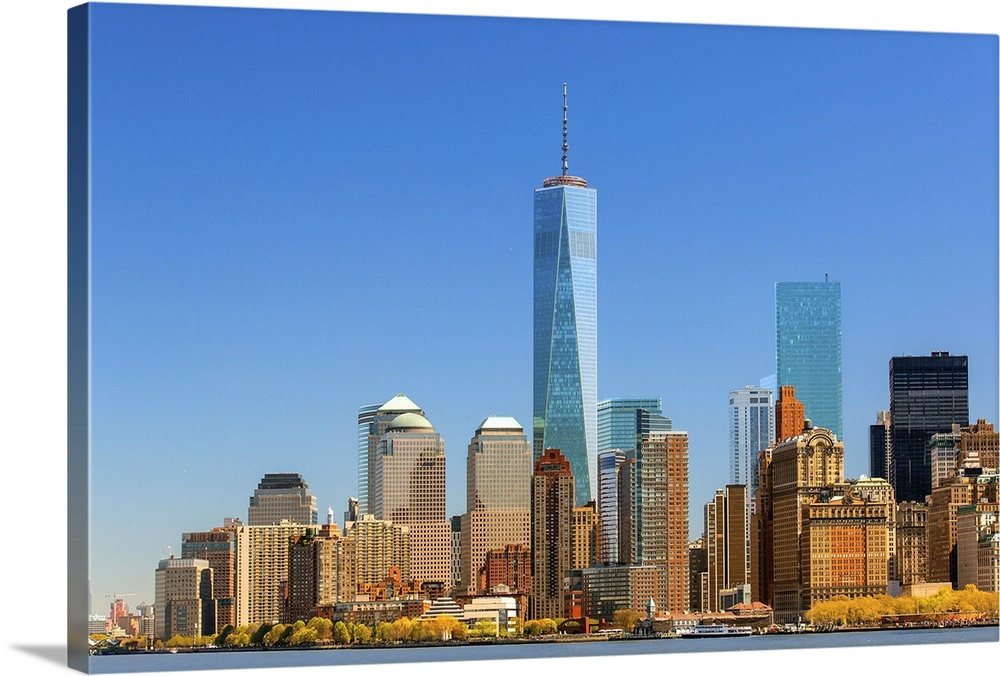 Large Solid-Faced Canvas Print Wall Art Print 36 x 24 entitled Skyline of New York with one World Trade Center Solid-Faced Canvas Print entitled Skyline of New York with one World Trade Center.  New-York with the Freedom Tower, One World Trade Center.  Multiple sizes available.  Primary colors within this image include Brown, Peach, Royal Blue, Light Gray Blue.  Made in USA.  Satisfaction guaranteed.  Archival-quality UV-resistant inks.  Featuring a proprietary design, our canvases produce the tightest corners without any bubbles, ripples, or bumps and will not warp or sag over time.  Canvas is handcrafted and made-to-order in the United States using high quality artist-grade canvas.