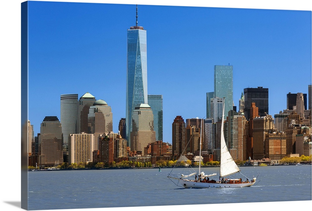 Large Solid-Faced Canvas Print Wall Art Print 36 x 24 entitled Skyline of New York with one World Trade Center Solid-Faced Canvas Print entitled Skyline of New York with one World Trade Center.  New-York with the Freedom Tower, One World Trade Center.  Multiple sizes available.  Primary colors within this image include Brown, Black, Gray, Royal Blue.  Made in USA.  All products come with a 365 day workmanship guarantee.  Archival-quality UV-resistant inks.  Canvas depth is 1.25 and includes a finished backing with pre-installed hanging hardware.  Featuring a proprietary design, our canvases produce the tightest corners without any bubbles, ripples, or bumps and will not warp or sag over time.