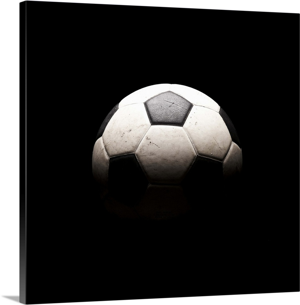 Large Solid-Faced Canvas Print Wall Art Print 20 x 20 entitled Soccer ball in shadows Solid-Faced Canvas Print entitled Soccer ball in shadows.  Multiple sizes available.  Primary colors within this image include Black, Gray, White.  Made in the USA.  Satisfaction guaranteed.  Archival-quality UV-resistant inks.  Archival inks prevent fading and preserve as much fine detail as possible with no over-saturation or color shifting.  Canvas depth is 1.25 and includes a finished backing with pre-installed hanging hardware.