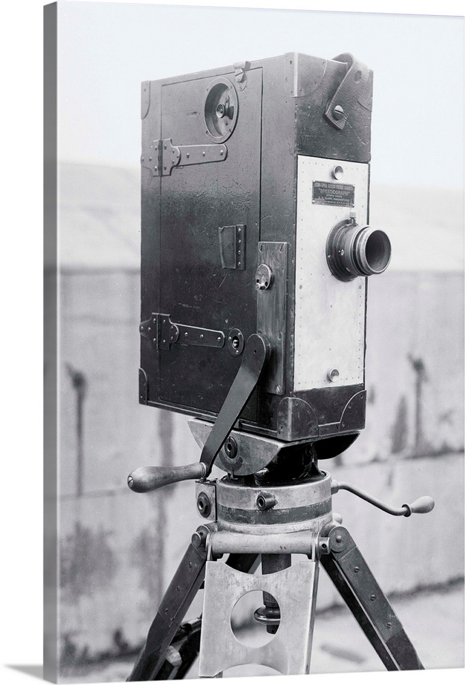 Large Solid-Faced Canvas Print Wall Art Print 20 x 30 entitled Speedograph Camera Solid-Faced Canvas Print entitled Speedograph Camera.  Inventor of New picture machine. O.H. Clark inventor of the new Speedograph movie camera with same. The new Speedograph movie camera.  Multiple sizes available.  Primary colors within this image include Black, Gray, White.  Made in USA.  All products come with a 365 day workmanship guarantee.  Inks used are latex-based and designed to last.  Featuring a proprietary design, our canvases produce the tightest corners without any bubbles, ripples, or bumps and will not warp or sag over time.  Canvas is handcrafted and made-to-order in the United States using high quality artist-grade canvas.