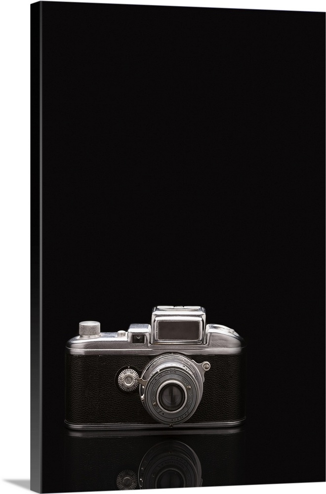 Large Solid-Faced Canvas Print Wall Art Print 20 x 30 entitled Studio shot of vintage camera Solid-Faced Canvas Print entitled Studio shot of vintage camera.  Multiple sizes available.  Primary colors within this image include Black, Gray, White.  Made in USA.  Satisfaction guaranteed.  Archival-quality UV-resistant inks.  Canvas depth is 1.25 and includes a finished backing with pre-installed hanging hardware.  Archival inks prevent fading and preserve as much fine detail as possible with no over-saturation or color shifting.