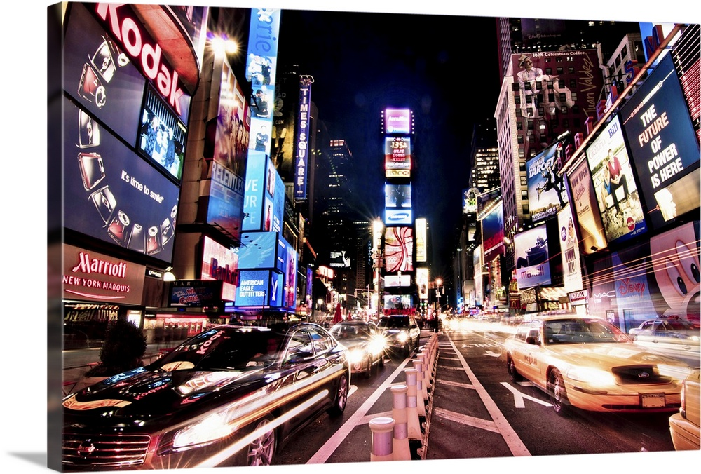 Large Solid-Faced Canvas Print Wall Art Print 30 x 20 entitled The heart of Times Square Manhattan, at night, with glowing... Solid-Faced Canvas Print entitled The heart of Times Square Manhattan, at night, with glowing neon signs and ads.  Photograph of busy street at iconic city block in the Big Apple.  The streets are lined by tall lit up buildings and skyscrapers.  Multiple sizes available.  Primary colors within this image include Plum, Sky Blue, Black, White.  Made in USA.  Satisfaction guaranteed.  Archival-quality UV-resistant inks.  Featuring a proprietary design, our canvases produce the tightest corners without any bubbles, ripples, or bumps and will not warp or sag over time.  Canvas is handcrafted and made-to-order in the United States using high quality artist-grade canvas.