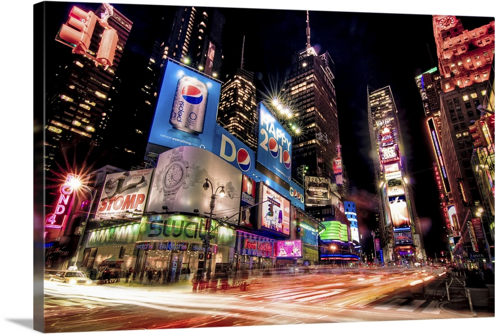 Large Solid-Faced Canvas Print Wall Art Print 30 x 20 entitled Times Square at night with glowing neon, car light trails. Solid-Faced Canvas Print entitled Times Square at night with glowing neon, car light trails..  Night photograph of the bright lights of Times Square in New York City, New York.  Multiple sizes available.  Primary colors within this image include Plum, Pink, Black, White.  Made in USA.  Satisfaction guaranteed.  Inks used are latex-based and designed to last.  Featuring a proprietary design, our canvases produce the tightest corners without any bubbles, ripples, or bumps and will not warp or sag over time.  Canvas is handcrafted and made-to-order in the United States using high quality artist-grade canvas.