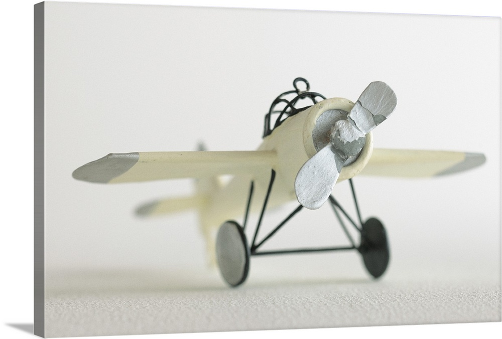 Large Solid-Faced Canvas Print Wall Art Print 30 x 20 entitled Toy airplane Solid-Faced Canvas Print entitled Toy airplane.  Multiple sizes available.  Primary colors within this image include Black, Gray, White.  Made in the USA.  Satisfaction guaranteed.  Archival-quality UV-resistant inks.  Archival inks prevent fading and preserve as much fine detail as possible with no over-saturation or color shifting.  Featuring a proprietary design, our canvases produce the tightest corners without any bubbles, ripples, or bumps and will not warp or sag over time.