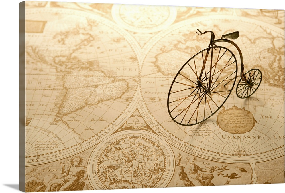 Large Solid-Faced Canvas Print Wall Art Print 30 x 20 entitled Toy bicycle and map Solid-Faced Canvas Print entitled Toy bicycle and map.  An antique toy bike on top of an old map of the world.  Multiple sizes available.  Primary colors within this image include White, Dark Forest Green.  Made in the USA.  Satisfaction guaranteed.  Archival-quality UV-resistant inks.  Featuring a proprietary design, our canvases produce the tightest corners without any bubbles, ripples, or bumps and will not warp or sag over time.  Archival inks prevent fading and preserve as much fine detail as possible with no over-saturation or color shifting.