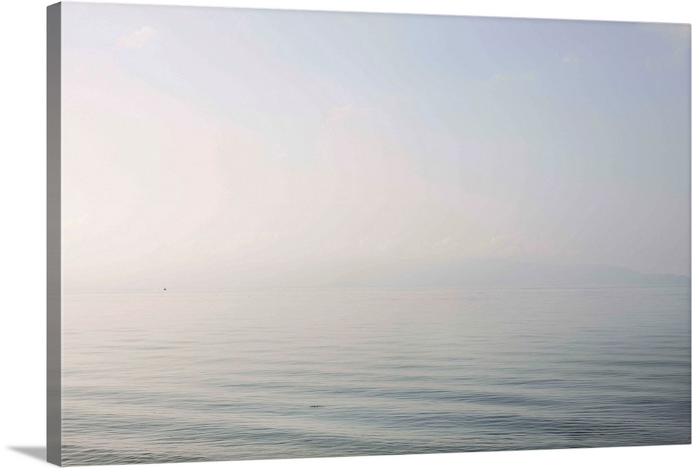 Large Gallery-Wrapped Canvas Wall Art Print 30 x 20 entitled Tranquil ocean view Gallery-Wrapped Canvas entitled Tranquil ocean view.  The ocean looks soft - like a pillow stuffed with soft feathers.  Multiple sizes available.  Primary colors within this image include Black, White.  Made in the USA.  All products come with a 365 day workmanship guarantee.  Archival-quality UV-resistant inks.  Canvases have a UVB protection built in to protect against fading and moisture and are designed to last for over 100 years.  Canvas is acid-free and 20 millimeters thick.