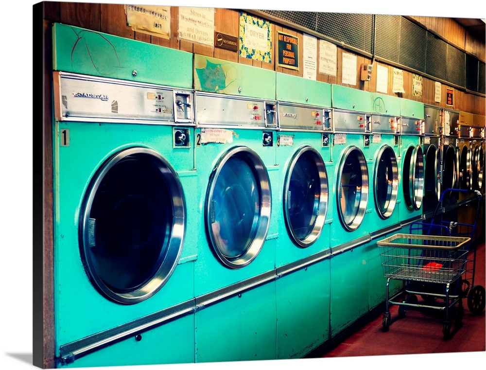 Large Solid-Faced Canvas Print Wall Art Print 40 x 30 entitled Washing machines in Laundromat. Solid-Faced Canvas Print entitled Washing machines in Laundromat..  Multiple sizes available.  Primary colors within this image include Black, White, Dark Forest Green, Teal.  Made in the USA.  All products come with a 365 day workmanship guarantee.  Inks used are latex-based and designed to last.  Canvas is handcrafted and made-to-order in the United States using high quality artist-grade canvas.  Canvas depth is 1.25 and includes a finished backing with pre-installed hanging hardware.