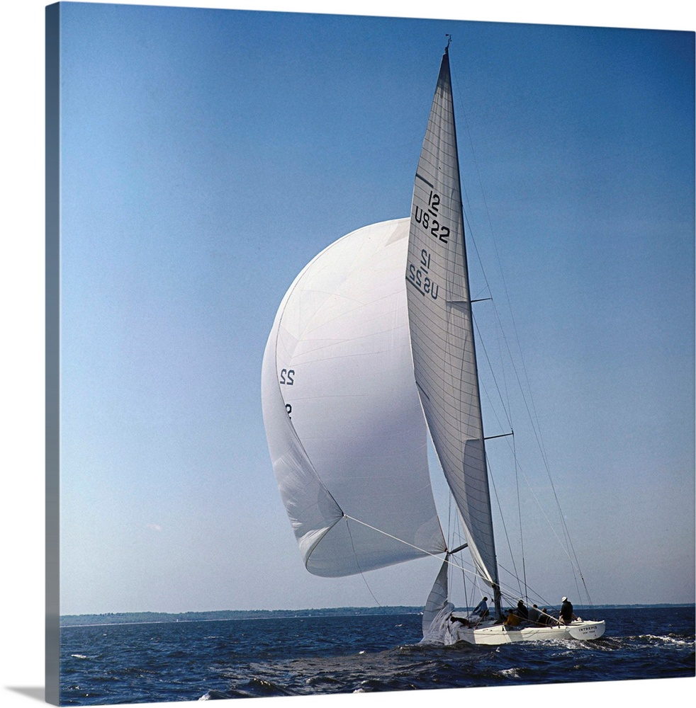 Large Solid-Faced Canvas Print Wall Art Print 20 x 20 entitled Windblown Sails of Yacht Intrepid on Open Sea Solid-Faced Canvas Print entitled Windblown Sails of Yacht Intrepid on Open Sea.  The 12 meter yacht Intrepid, is shown during sea workouts in Long Island Sound. The Intrepid and the Constellation was to begin trials June 5th to see which would defend against the Australian challenger in the upcoming Americas Cup Races.  Multiple sizes available.  Primary colors within this image include Dark Gray, Muted Blue, Pale Blue.  Made in USA.  All products come with a 365 day workmanship guarantee.  Inks used are latex-based and designed to last.  Featuring a proprietary design, our canvases produce the tightest corners without any bubbles, ripples, or bumps and will not warp or sag over time.  Canvas depth is 1.25 and includes a finished backing with pre-installed hanging hardware.