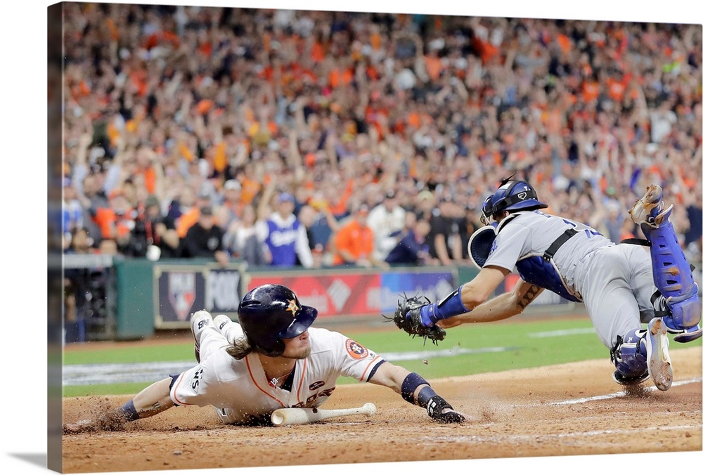 Large Solid-Faced Canvas Print Wall Art Print 30 x 20 entitled World Series - Los Angeles Dodgers vs. Houston Astros - Gam... Solid-Faced Canvas Print entitled World Series - Los Angeles Dodgers vs. Houston Astros - Game Three.  HOUSTON, TX - OCTOBER 27 Josh Reddick no. 22 of the Houston Astros slides in to home plate beating the tag of Austin Barnes no. 15 of the Los Angeles Dodgers during the fifth inning in game three of the 2017 World Series at Minute Maid Park on October 27, 2017 in Houston, Texas.  Multiple sizes available.  Primary colors within this image include Orange, Dark Red, Black, Gray.  Made in the USA.  Satisfaction guaranteed.  Archival-quality UV-resistant inks.  Archival inks prevent fading and preserve as much fine detail as possible with no over-saturation or color shifting.  Featuring a proprietary design, our canvases produce the tightest corners without any bubbles, ripples, or bumps and will not warp or sag over time.