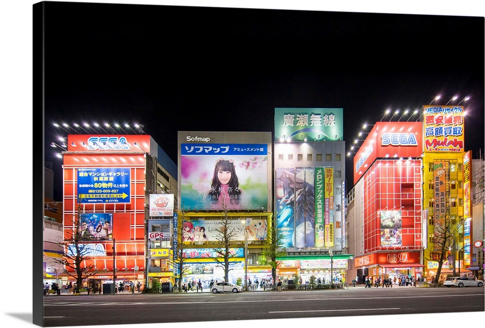 Large Solid-Faced Canvas Print Wall Art Print 30 x 20 entitled Akihabara electronic town, Tokyo, Japan Solid-Faced Canvas Print entitled Akihabara electronic town, Tokyo, Japan.  Akihabara electronic town, Tokyo, Japan.  Multiple sizes available.  Primary colors within this image include Red, Dark Blue, Pink, Black.  Made in USA.  Satisfaction guaranteed.  Inks used are latex-based and designed to last.  Canvas is handcrafted and made-to-order in the United States using high quality artist-grade canvas.  Featuring a proprietary design, our canvases produce the tightest corners without any bubbles, ripples, or bumps and will not warp or sag over time.