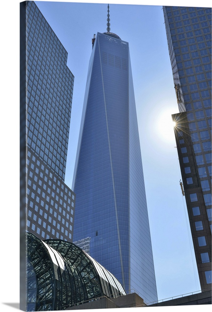 Large Solid-Faced Canvas Print Wall Art Print 24 x 36 entitled Freedom Tower at the World Financial Center, New York Solid-Faced Canvas Print entitled Freedom Tower at the World Financial Center, New York.  Freedom Tower at the World Financial Center, New York, USA.  Multiple sizes available.  Primary colors within this image include Black, Muted Blue, Pale Blue.  Made in USA.  All products come with a 365 day workmanship guarantee.  Archival-quality UV-resistant inks.  Canvas depth is 1.25 and includes a finished backing with pre-installed hanging hardware.  Archival inks prevent fading and preserve as much fine detail as possible with no over-saturation or color shifting.